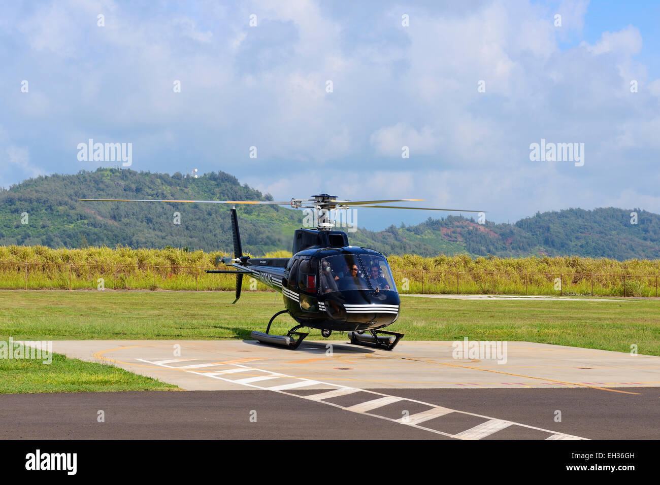 Aerospatiale AS350BA helicopter prepares for takeoff at Lihue International Airport, Lihue, Kauai, Hawaii, USA - Stock Image