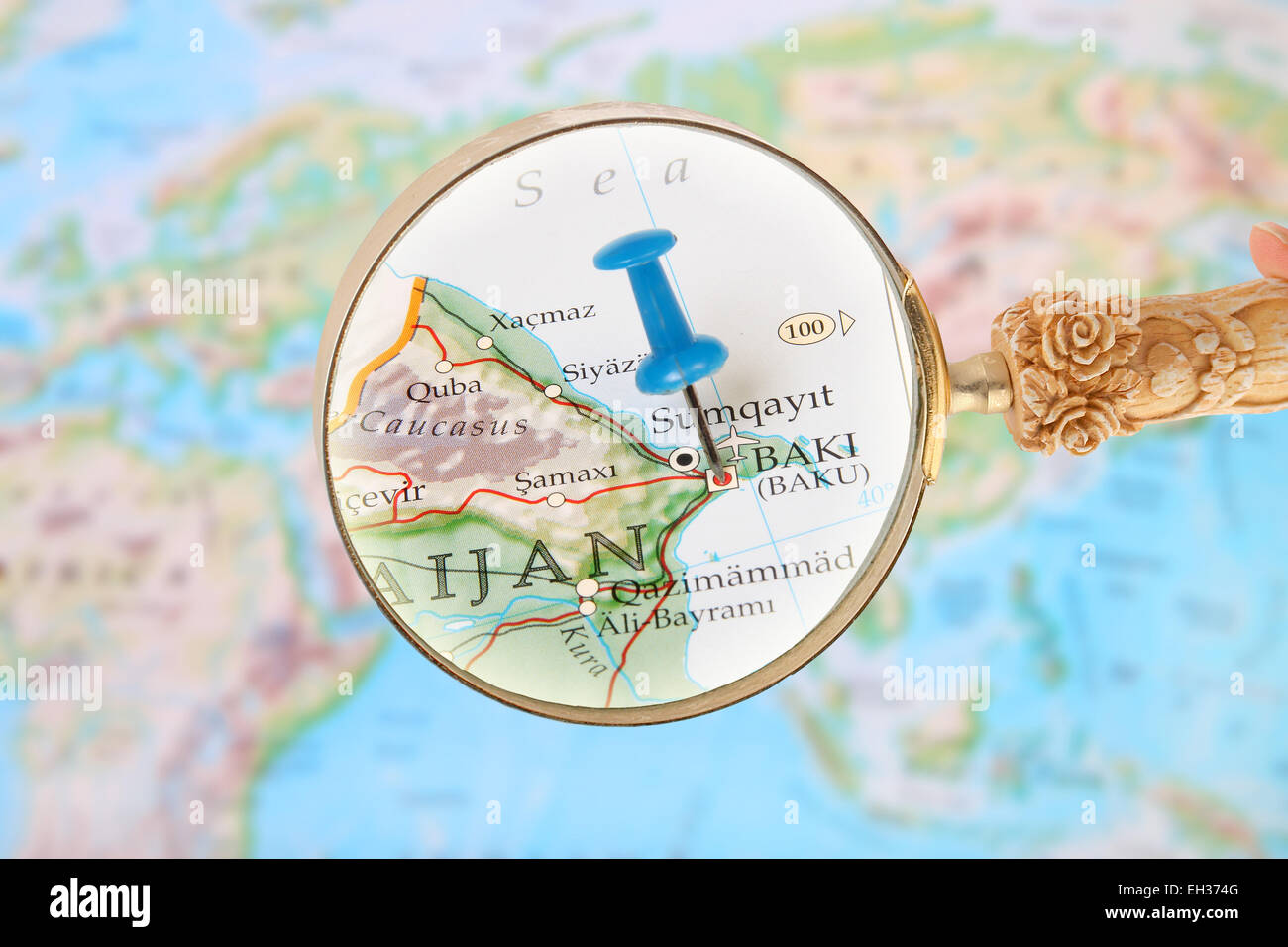 Picture of: Blue Tack On Map Of Asia With Magnifying Glass Looking In On Baki Or Stock Photo Alamy