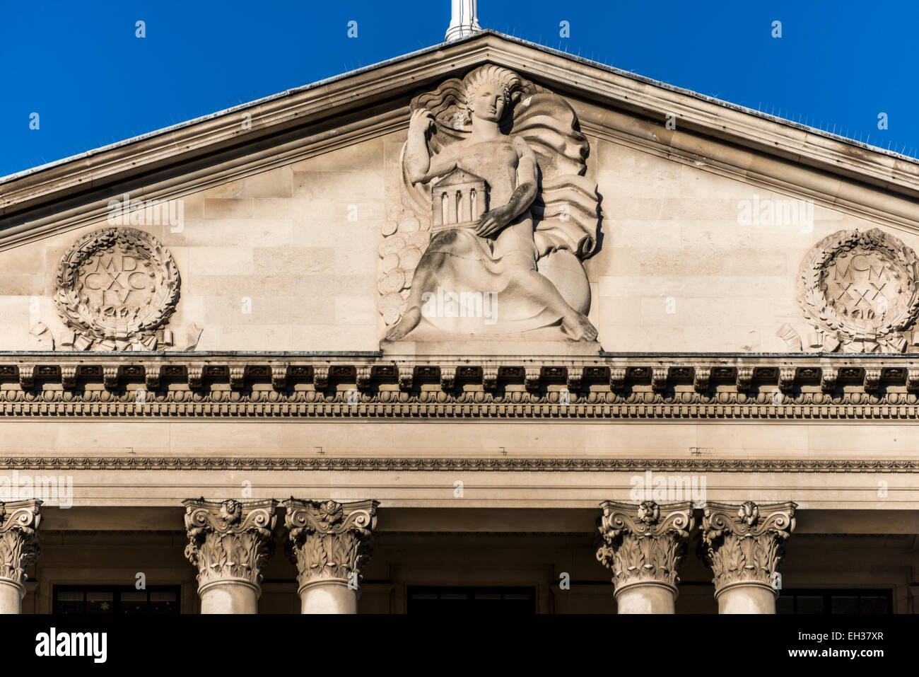 The top of the pediment over the Bank of England on Threadneedle Street in the City of London - Stock Image