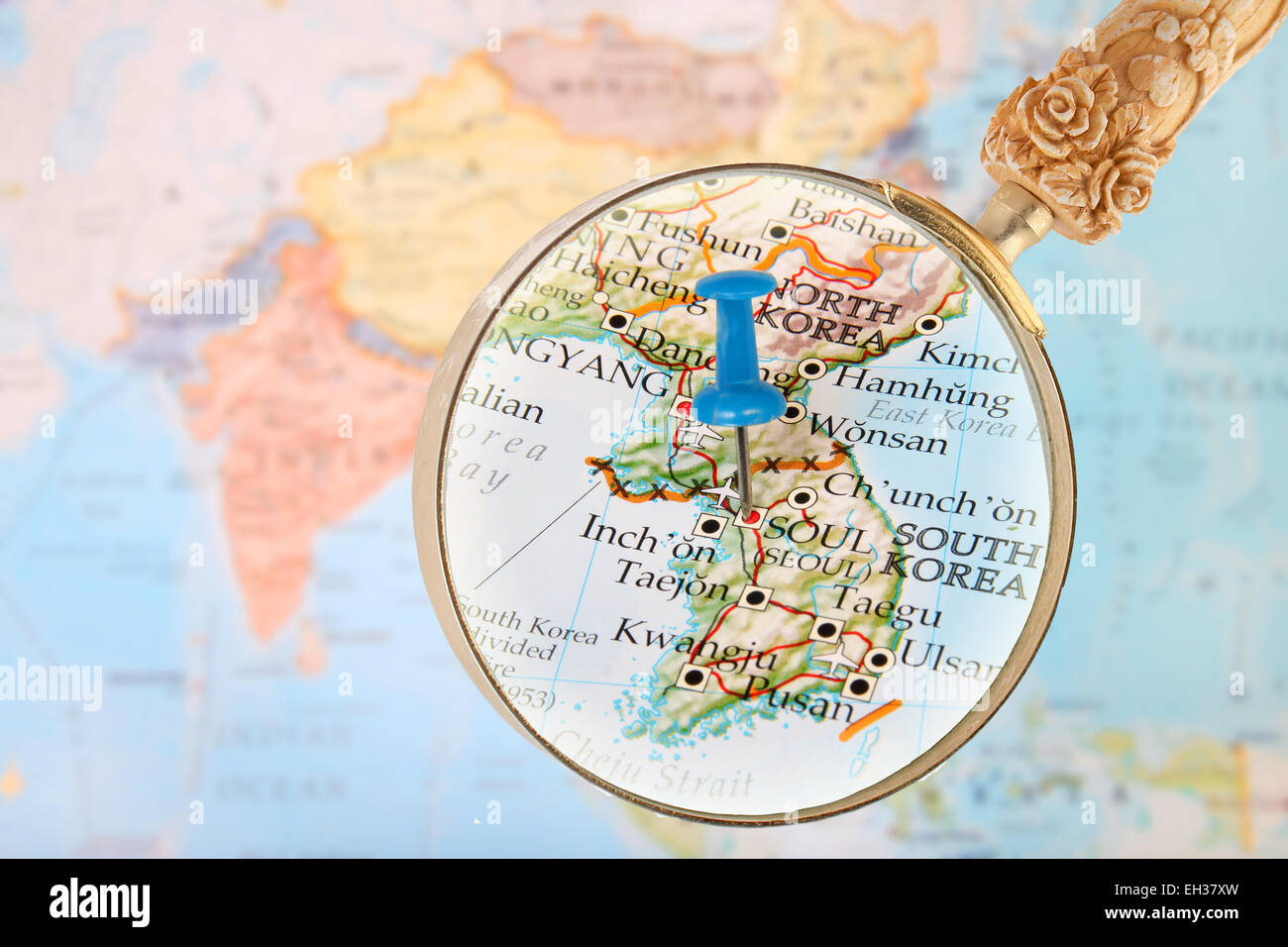 Blue Tack On Map Of Asia With Magnifying Glass Looking In Seoul