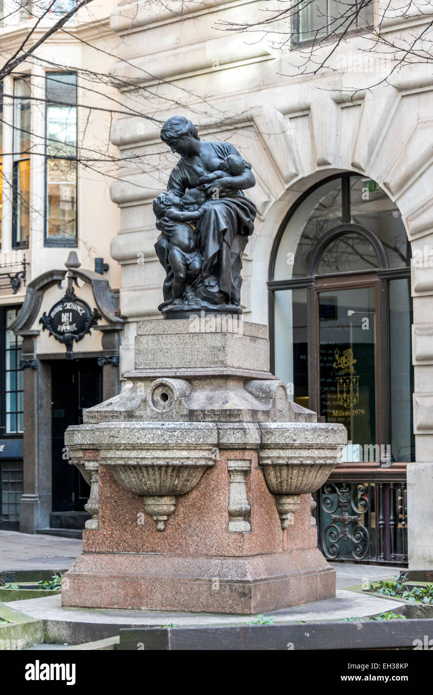 Charity (or Motherhood) is a drinking fountain on Royal Exchange Avenue in the City of London, by Jules Dalou - Stock Image