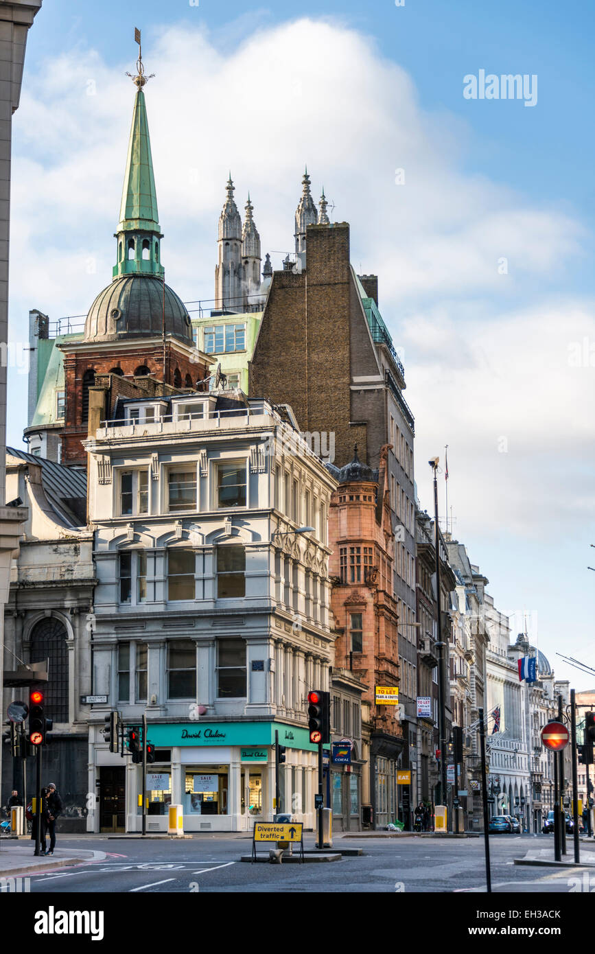 Views down Leadenhall St and Cornhill in the City of London including the church spires of St Peter upon Cornhill - Stock Image