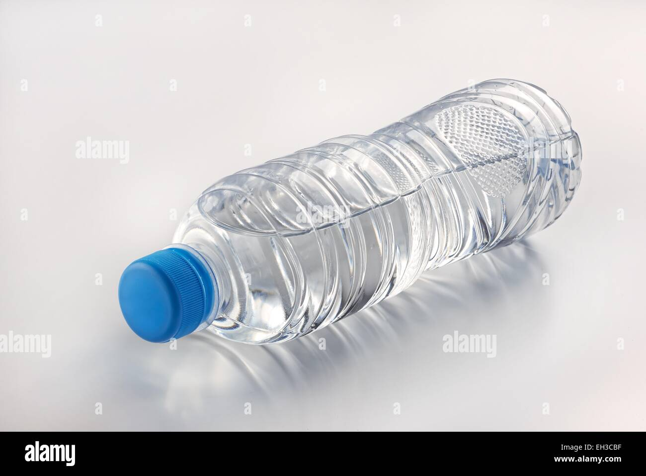 Mineral drinking water in a transparent container - Stock Image