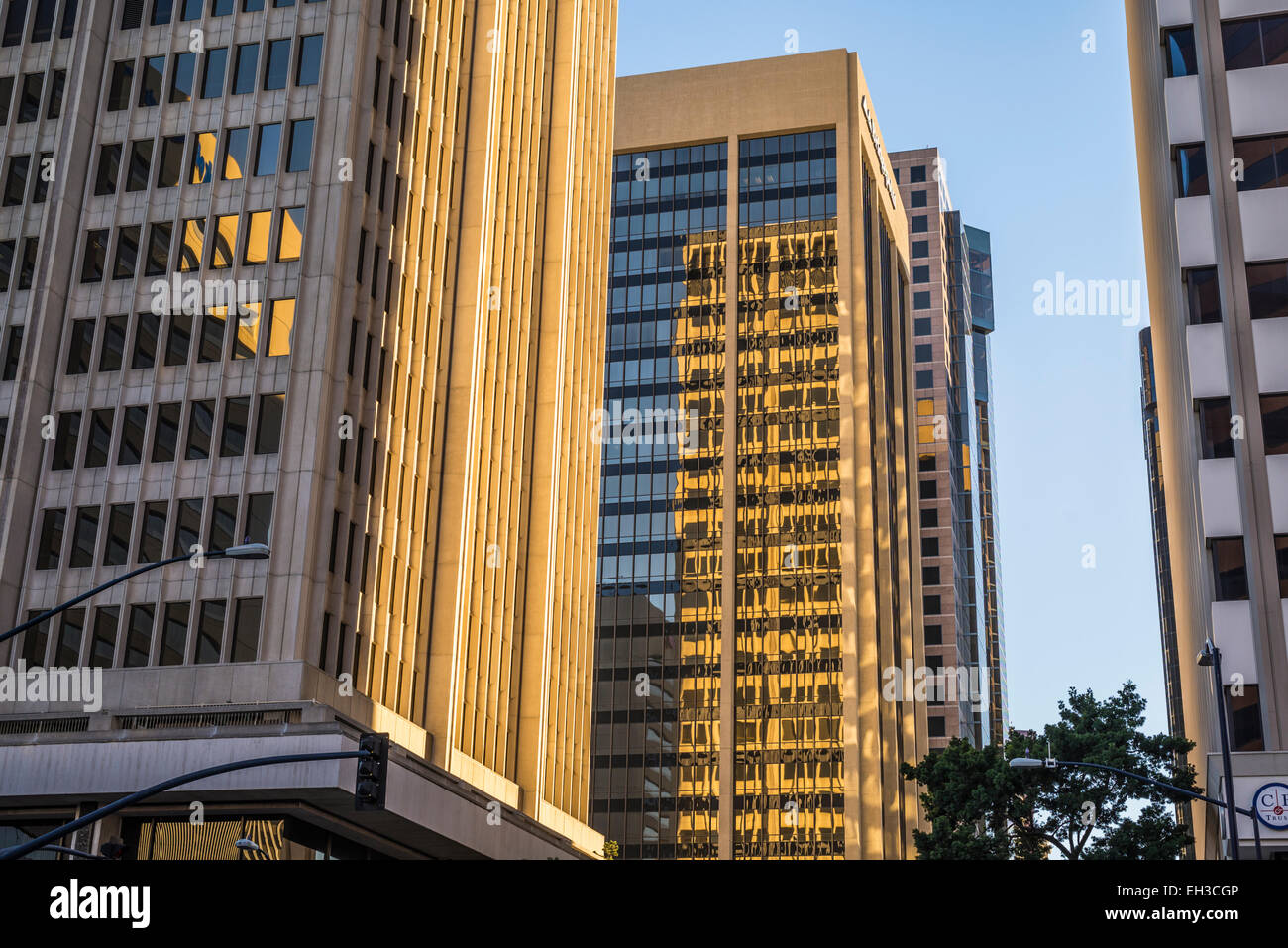 The rising Sun illuminating buildings in Downtown San Diego. San Diego, California, United States. - Stock Image