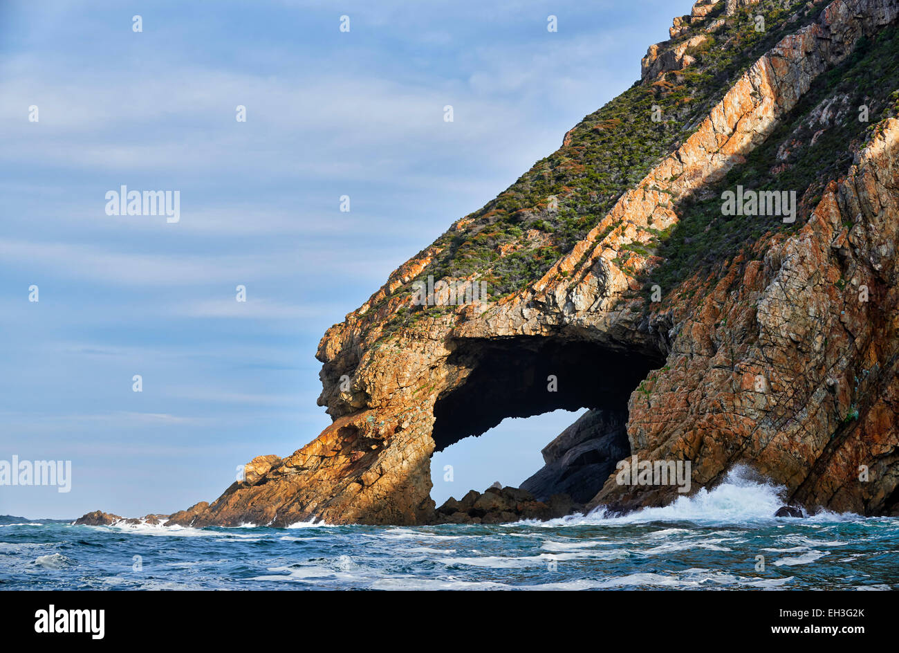 landscape from seaside with cliffs and cave at coastline, Western Cape, South Africa - Stock Image