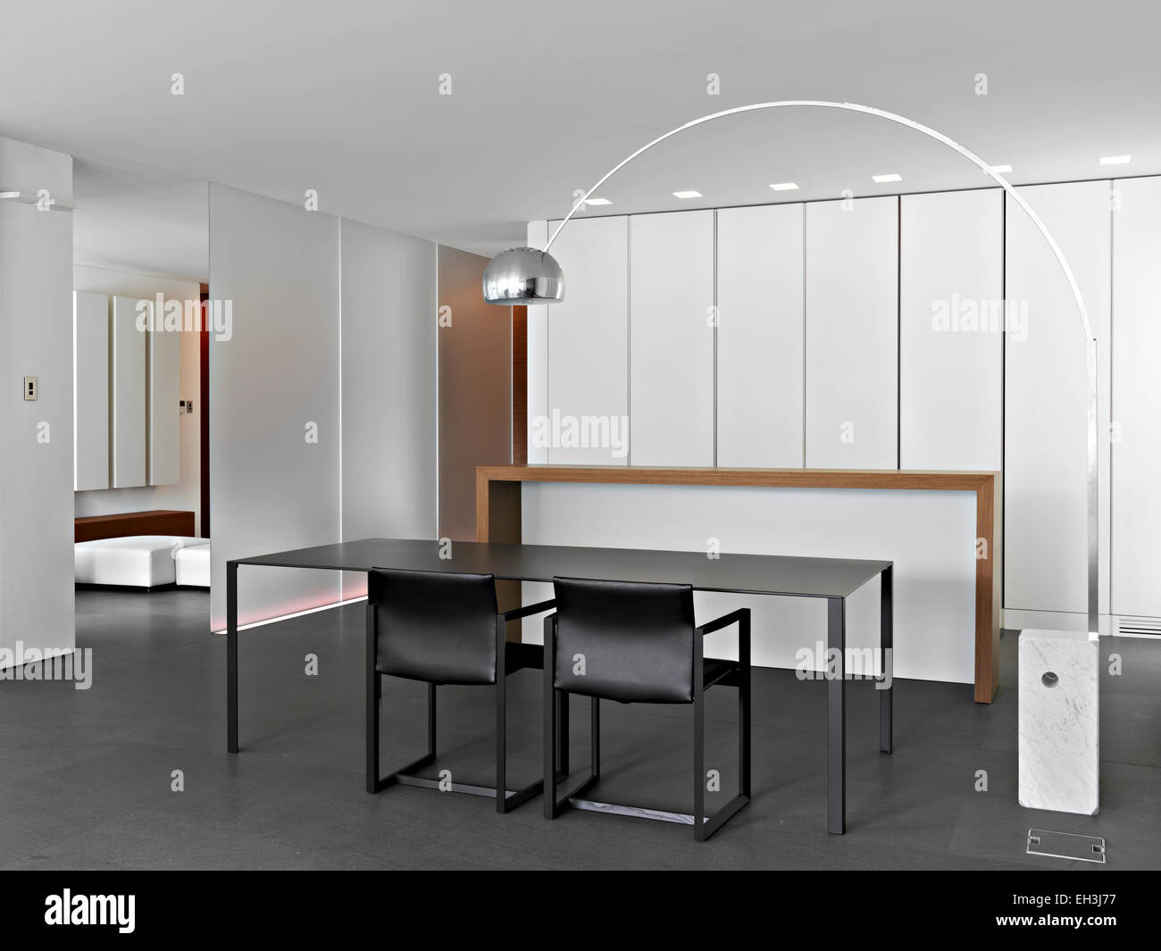 Interior View Of A Modern Dining Room With Dining Table In Foreground Stock Photo Alamy