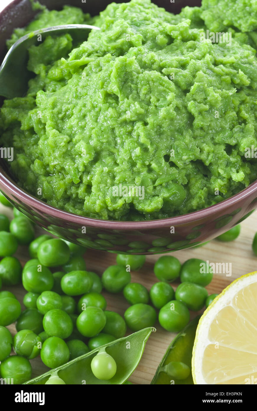 Pureed green peas in a bowl. - Stock Image