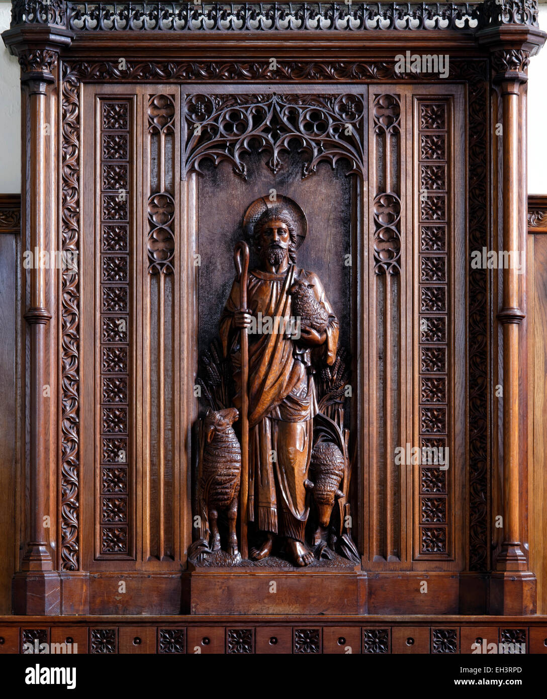The unique oak reredos in memory of J. Milner, rector of  St. Mary the Virgin Church, MIddleton-in-Teesdale, County - Stock Image