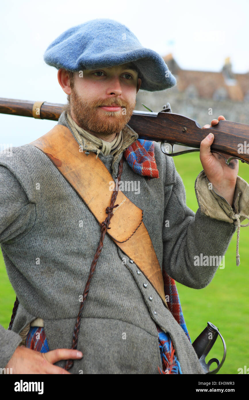 Scottish historical reenactment soldier at Duart Castle, the home of the Clan MacLean, on the Isle of Mull - Stock Image