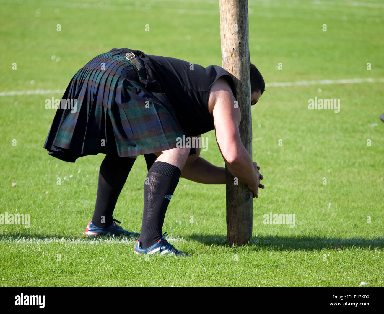 Nairn, Scotland - August 20, 2011: A competitor at the Highland Games preparing to perform a caber toss. - Stock Image