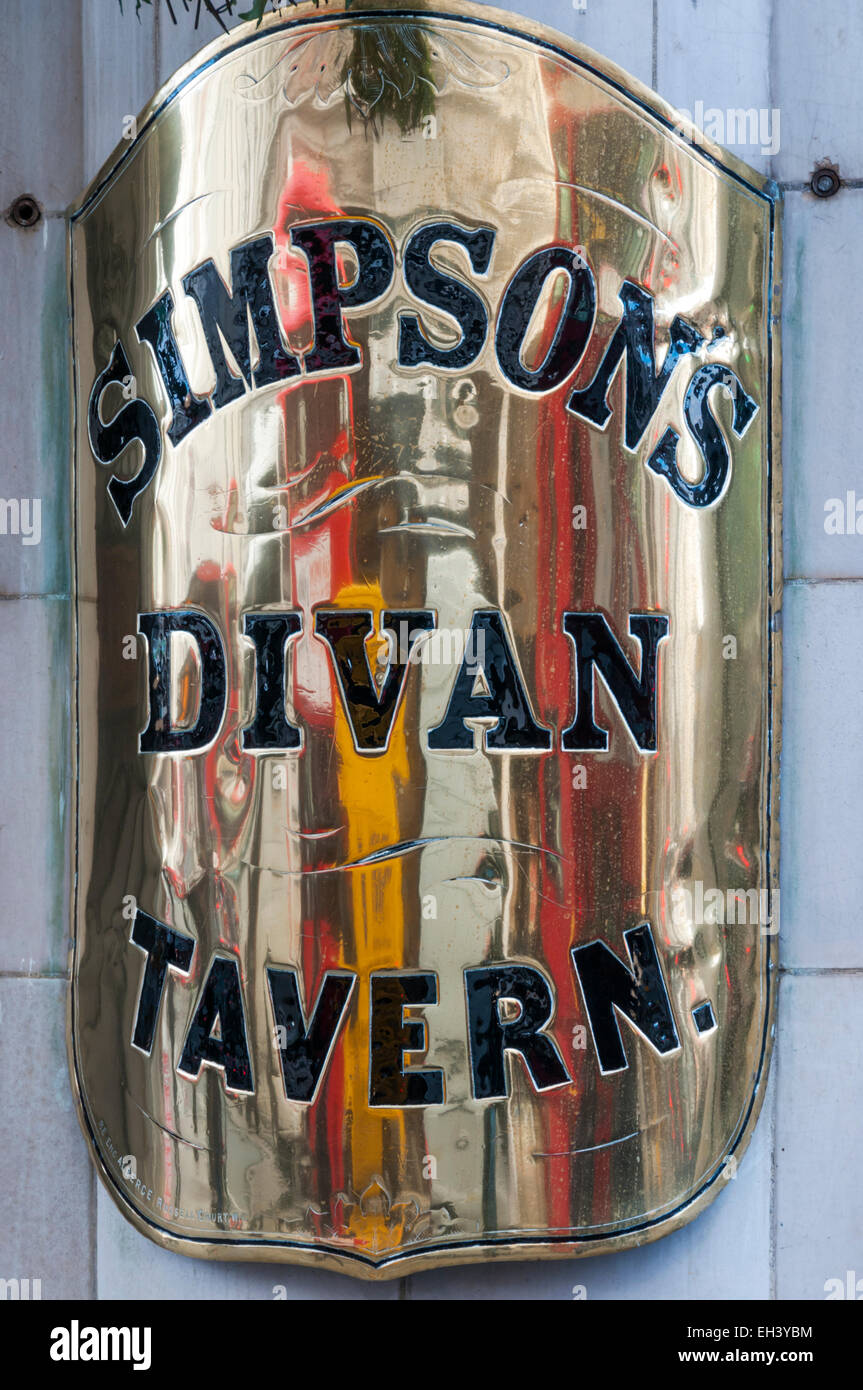 A brass nameplate outside Simpson's Divan Tavern in The Strand, London. - Stock Image