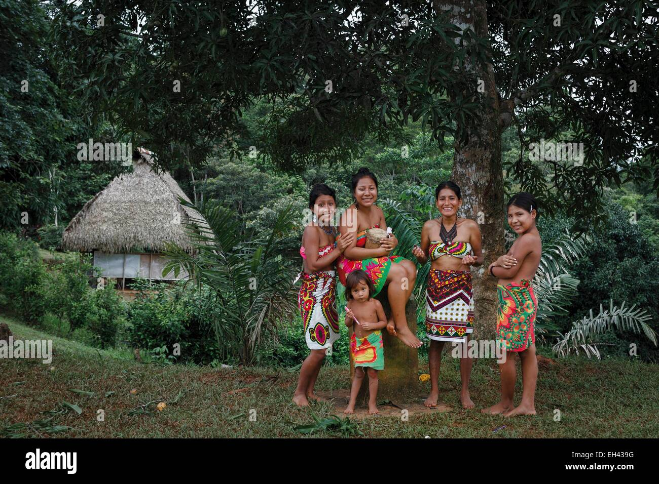 Panama, Darien province, Darien National Park, listed as World Heritage by UNESCO, Embera indigenous community, portrait of an Embera indigenous family in a tropical greenery Stock Photo