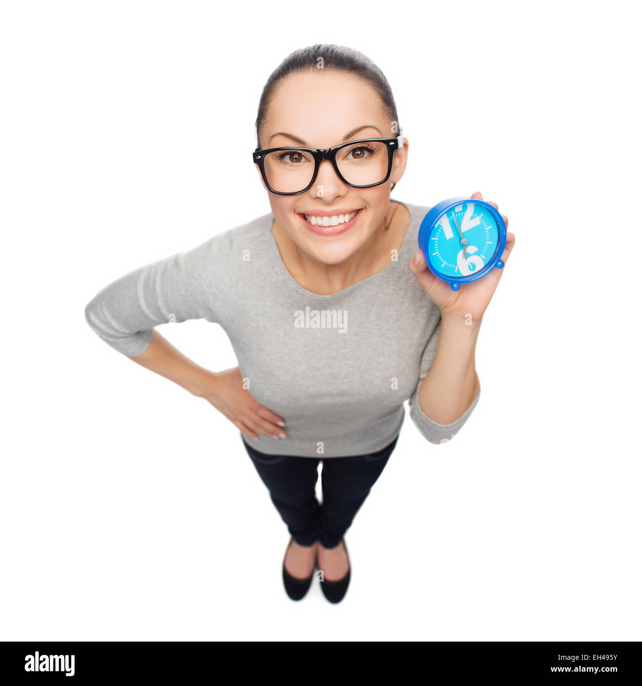 smiling woman in eyeglasses with blue clock - Stock Image