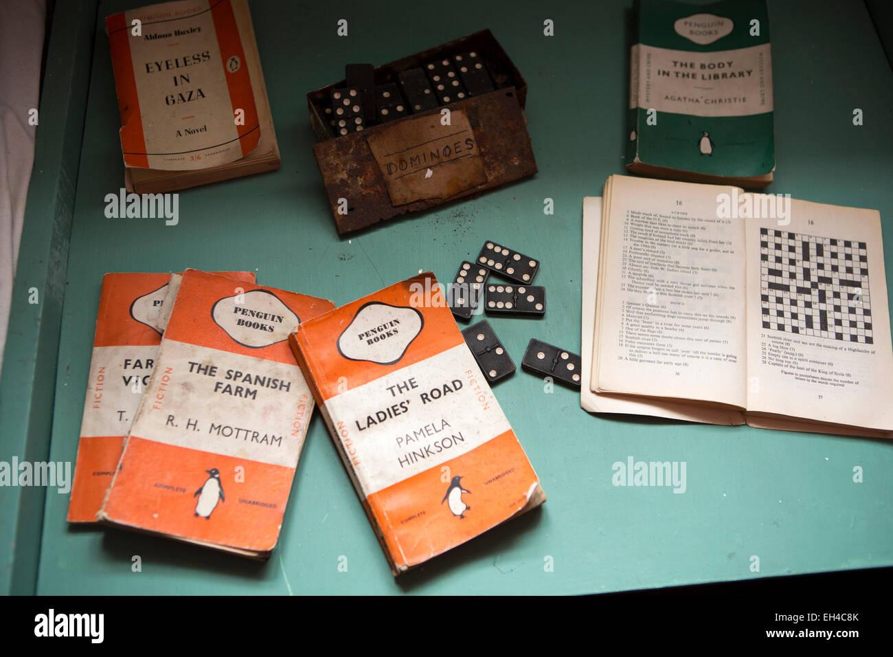 Antarctica, Port Lockroy British base museum, living quarters, penguin paperback books on bedside table - Stock Image