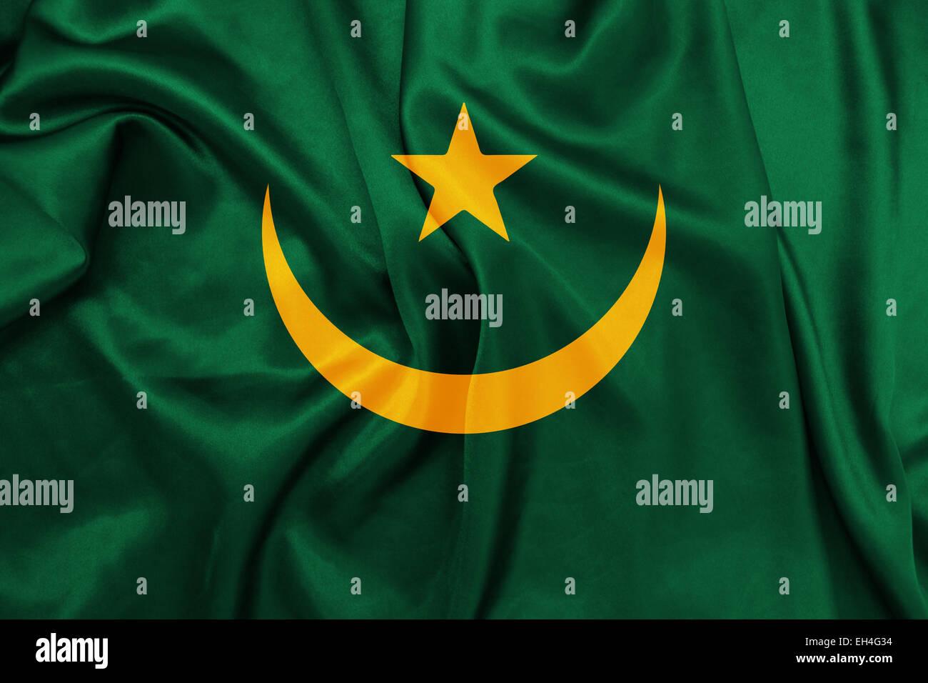 Mauritania - Waving national flag on silk texture - Stock Image
