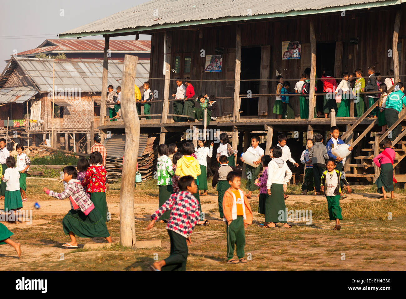 Burmese schoolchildren playing in their school playground, Kar Lar village primary school, Inle Lake, Myanmar ( - Stock Image