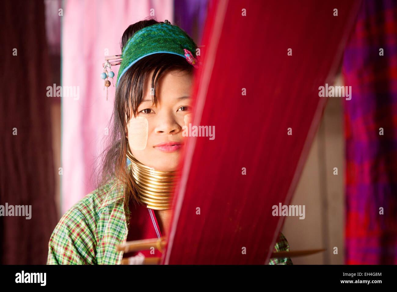 One of the long neck Burmese Kayan women weaving on her loom, Inle Lake, Myanmar ( Burma ), Asia Stock Photo