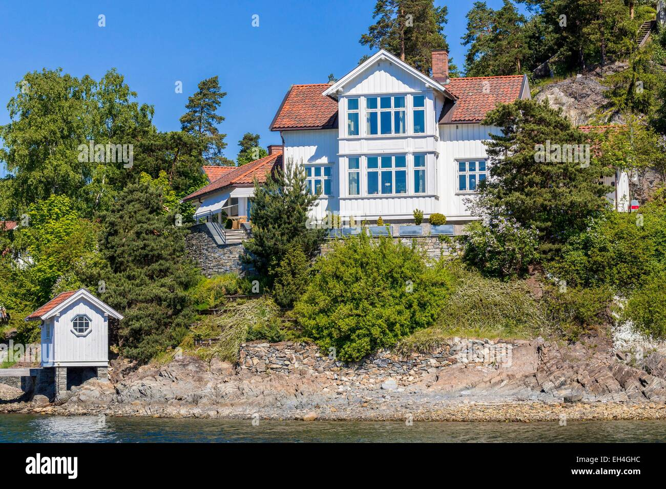 Norway, Oslo, Oslofjord, dwelling on one of the many islands Fjord - Stock Image