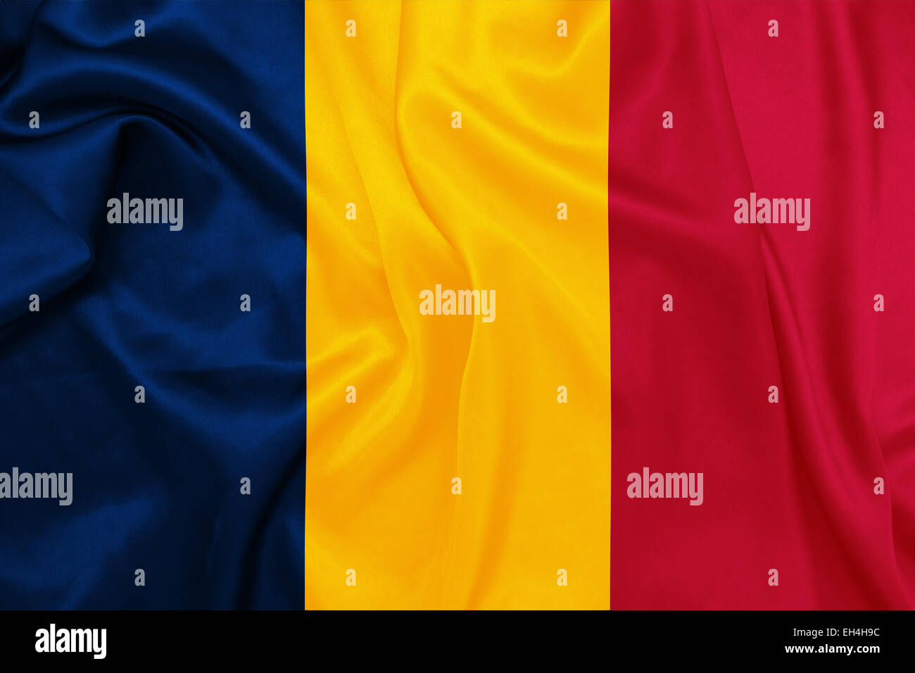 Chad - Waving national flag on silk texture Stock Photo