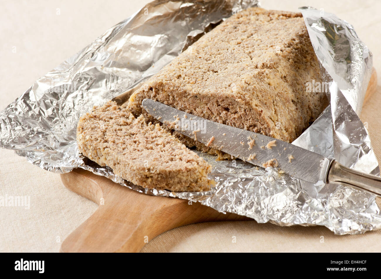 Home made poultry pate knife slicing - Stock Image