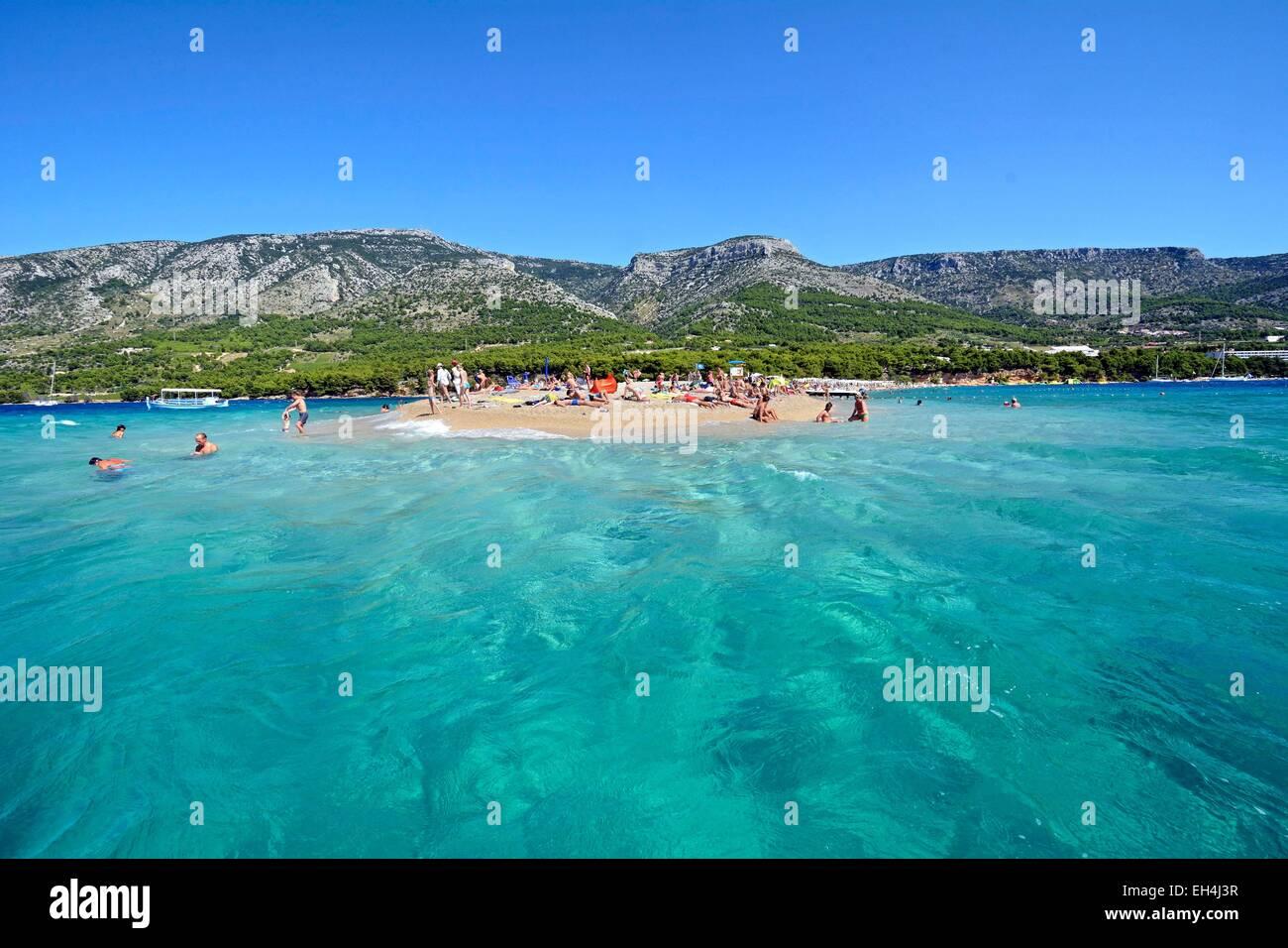 Croatia, Island Brac, beach Golden Horn popular with sunbathers in summer - Stock Image