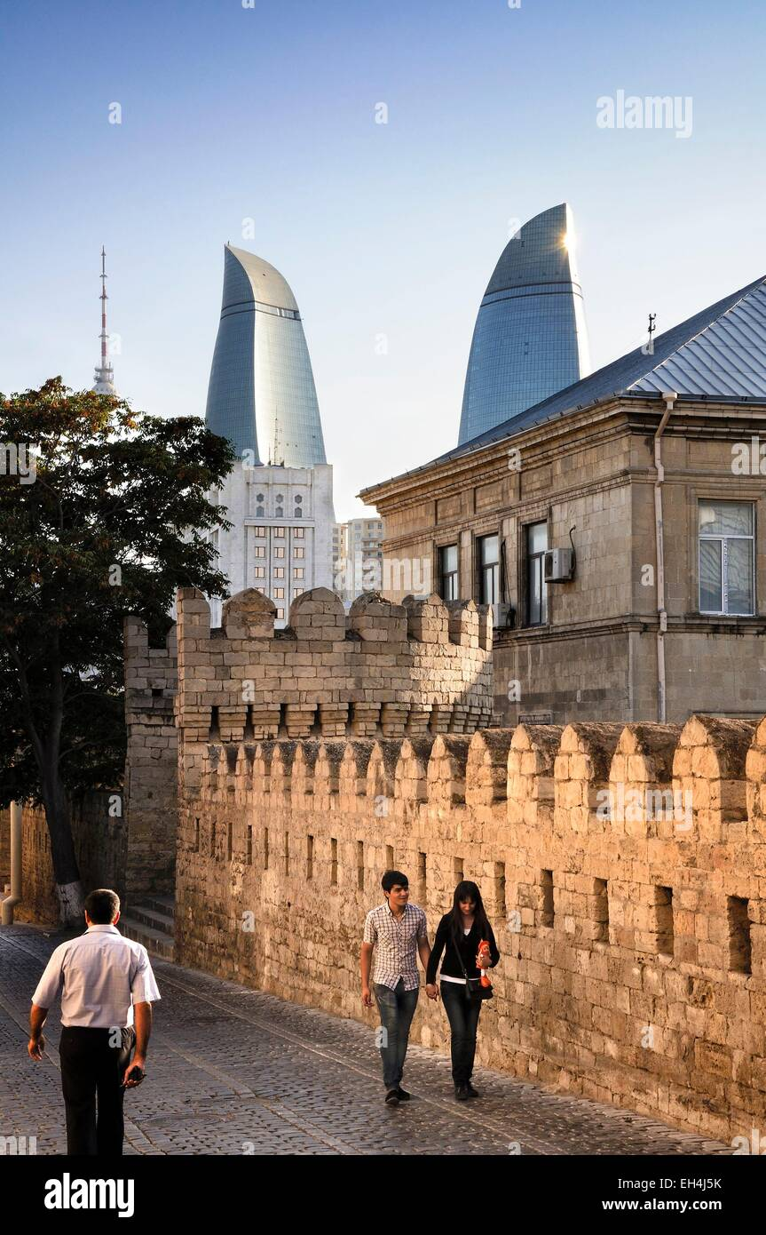 Azerbaijan, Baku, street and fortification walls of the Old City listed as World Heritage by UNESCO, the Flame Towers - Stock Image