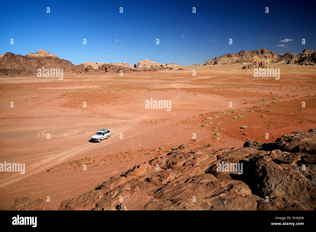 Jordan, Wadi Rum desert, protected area listed as World Heritage by UNESCO, car, red sand desert and rocks - Stock Image