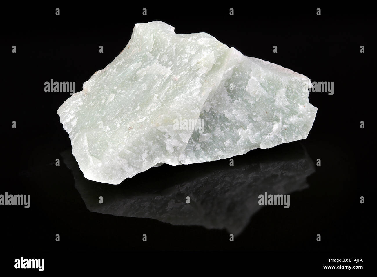 Quartzite rock specimen black background - Stock Image