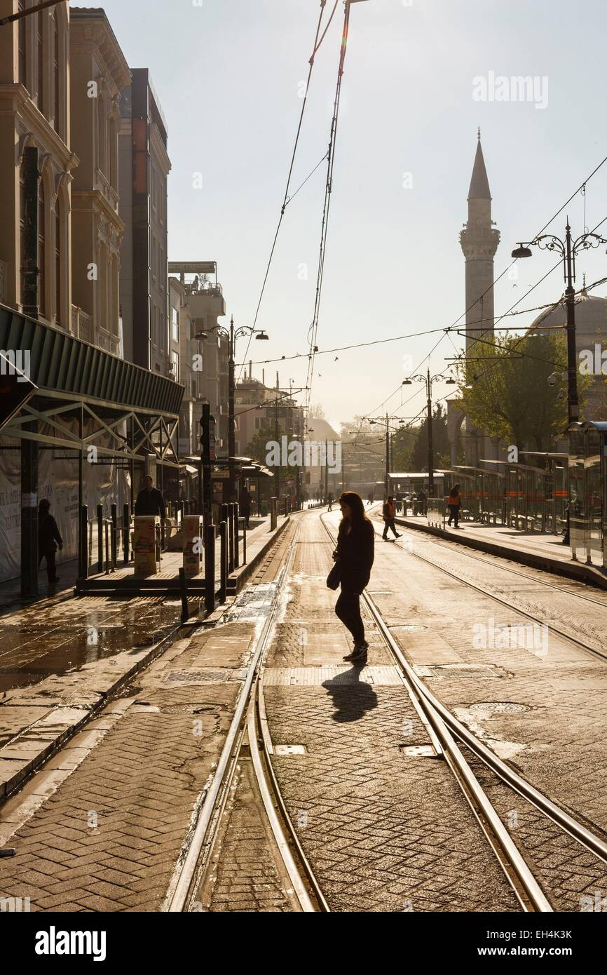 Turkey, Istanbul, user crossing the tram line at the Sultanahmet stop against the light - Stock Image