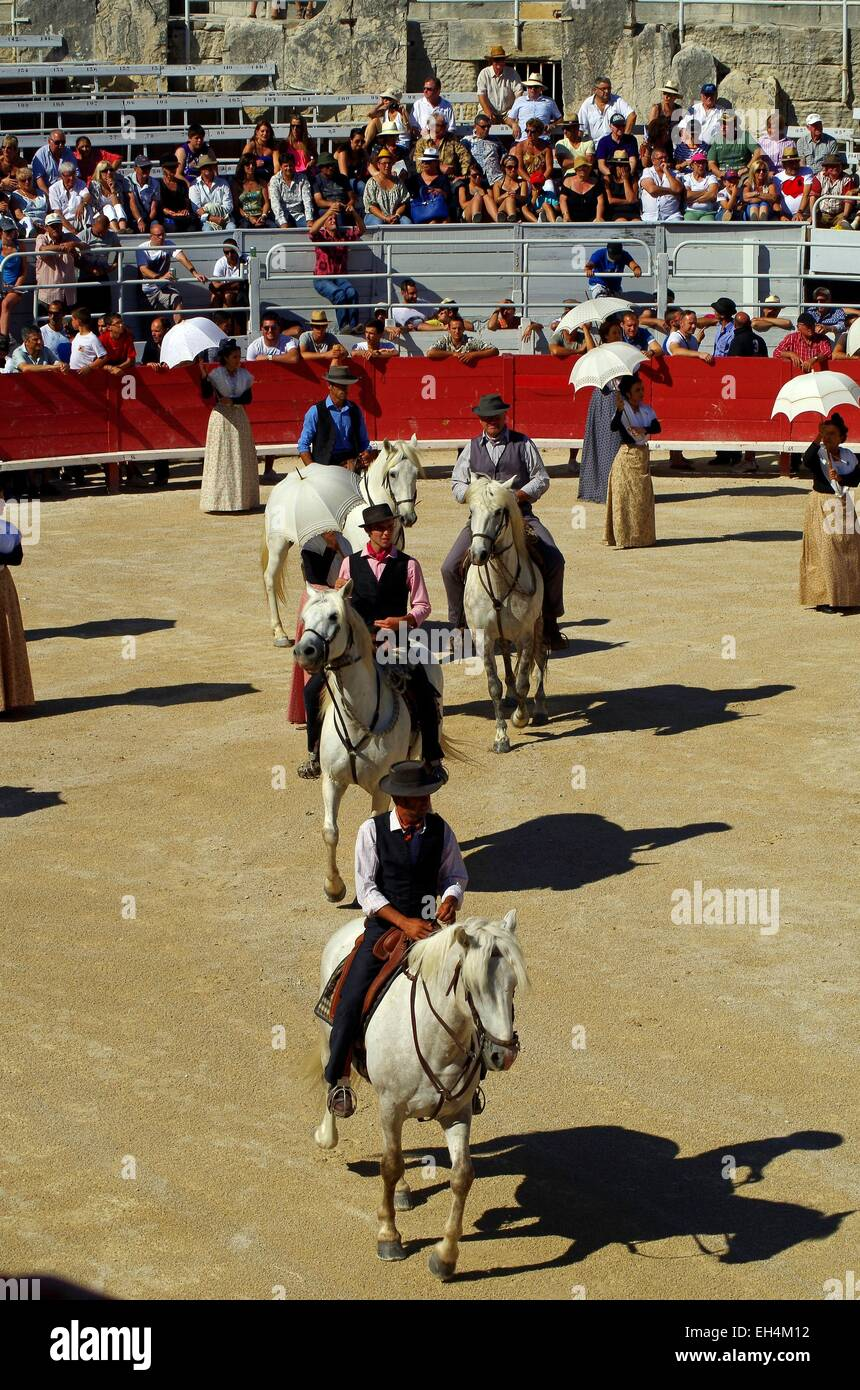 France, Bouches du Rhone, Arles, Roman Arenas, listed as World Heritage by UNESCO, gardians festival - Stock Image