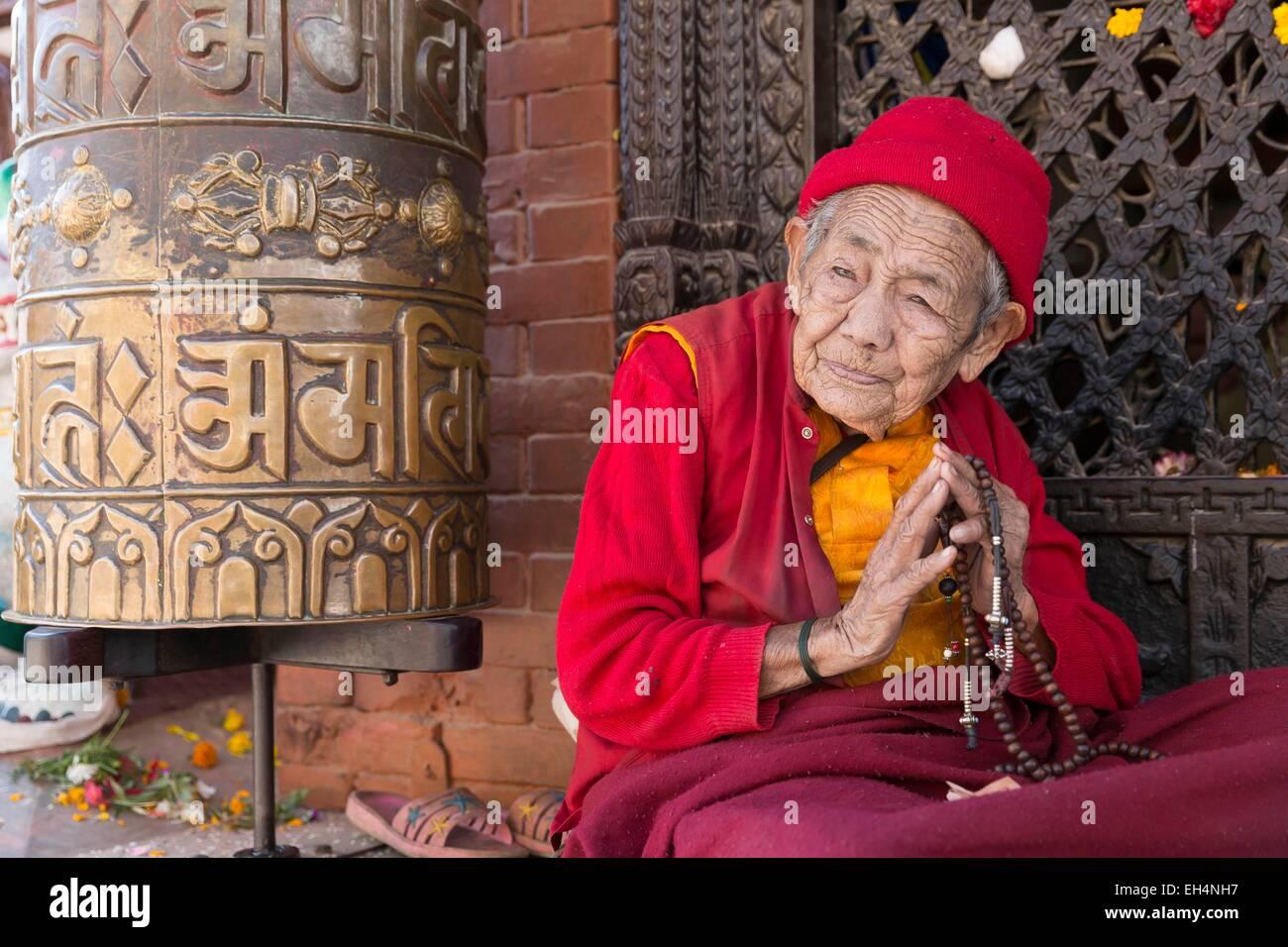 Nepal, Kathmandu, Bodhnath, listed as World Heritage by UNESCO, pilgrim near the Buddhist temple - Stock Image