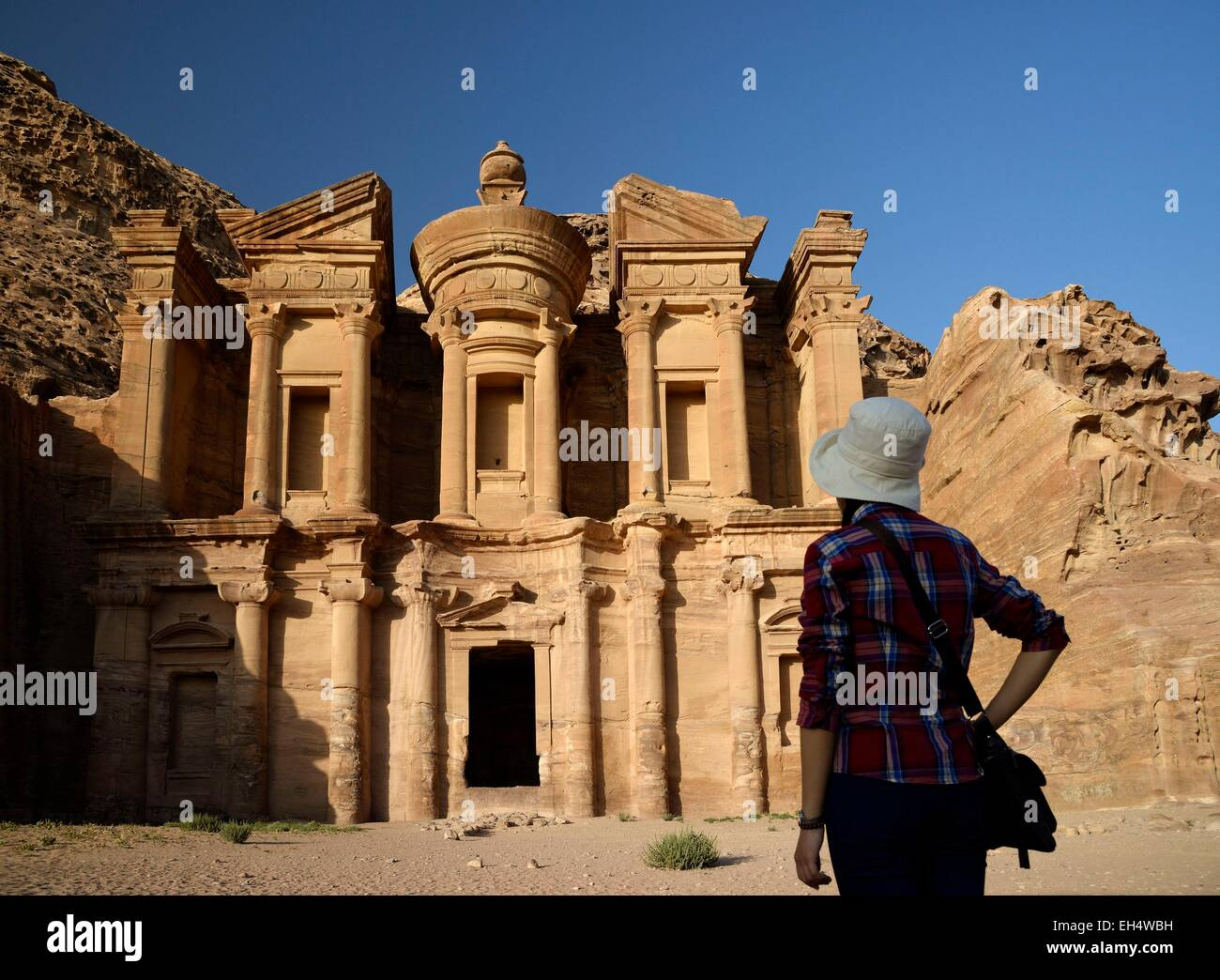 Jordan, Nabataean archeological site of Petra, listed as World Heritage by UNESCO, silhouette of a woman watching - Stock Image