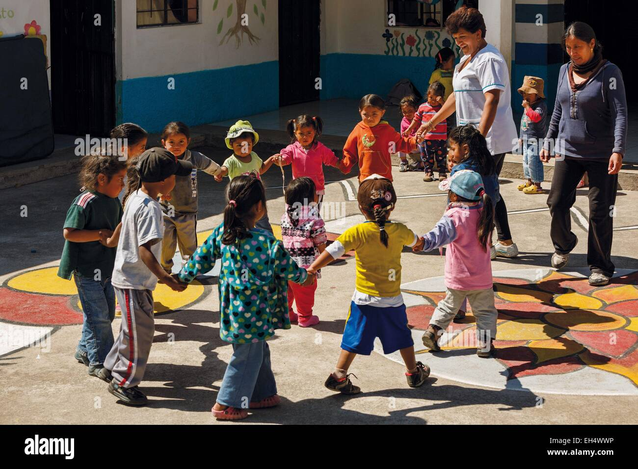 Ecuador, Imbabura, Chilcapamba, young children making a round in the yard of a rural school - Stock Image