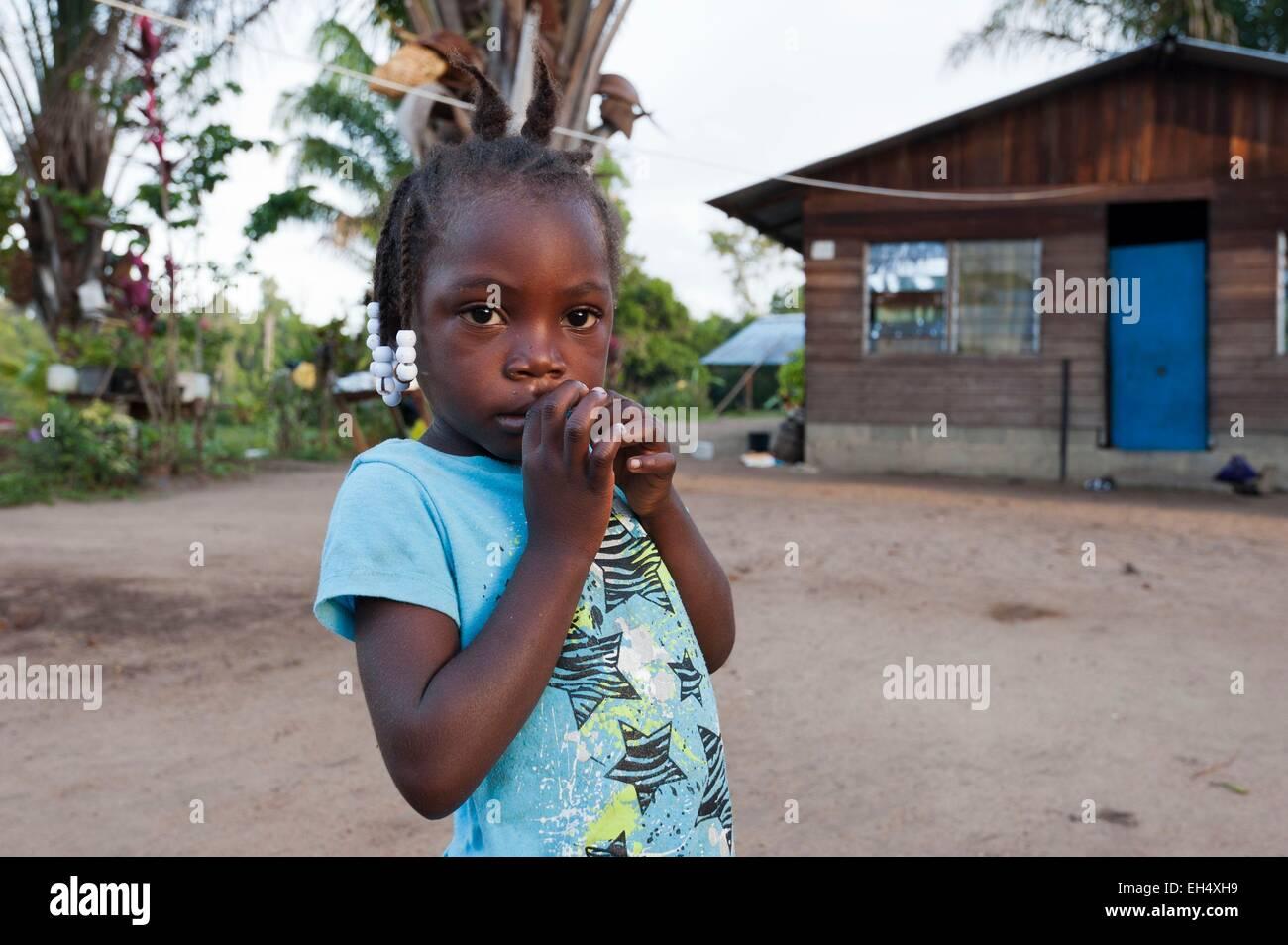 France, French Guiana, Parc Amazonien de Guyane (Guiana Amazonian Park), Belikampoe, portrait of a little girl - Stock Image