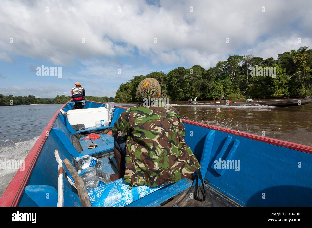 Republic of Suriname, two pirogues crossing on the Tapanahony River an affluent of Maroni - Stock Image