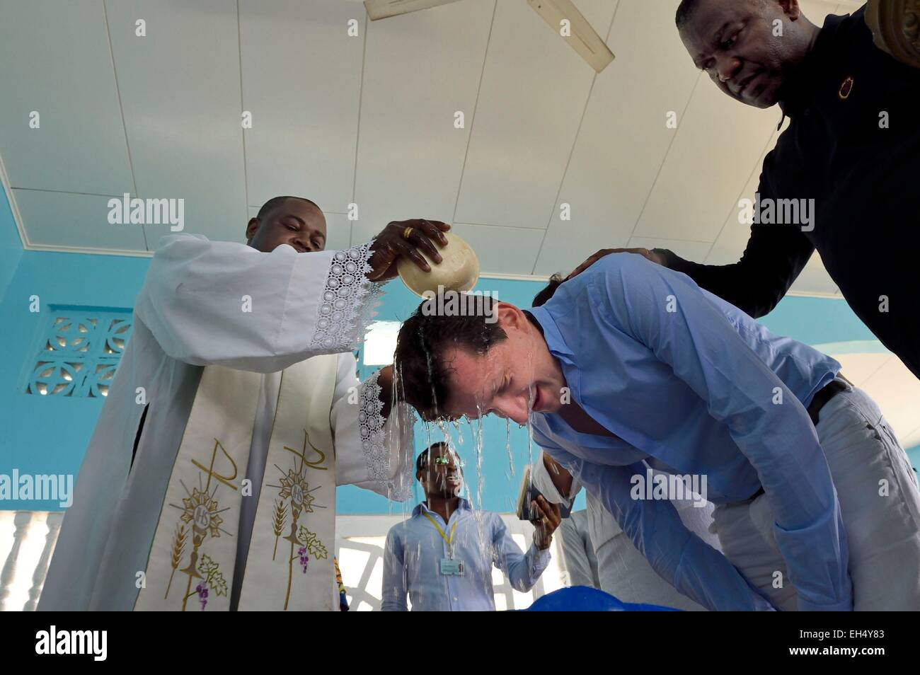 Gabon, Libreville, St. Mary's Cathedral, baptism of an adult man - Stock Image
