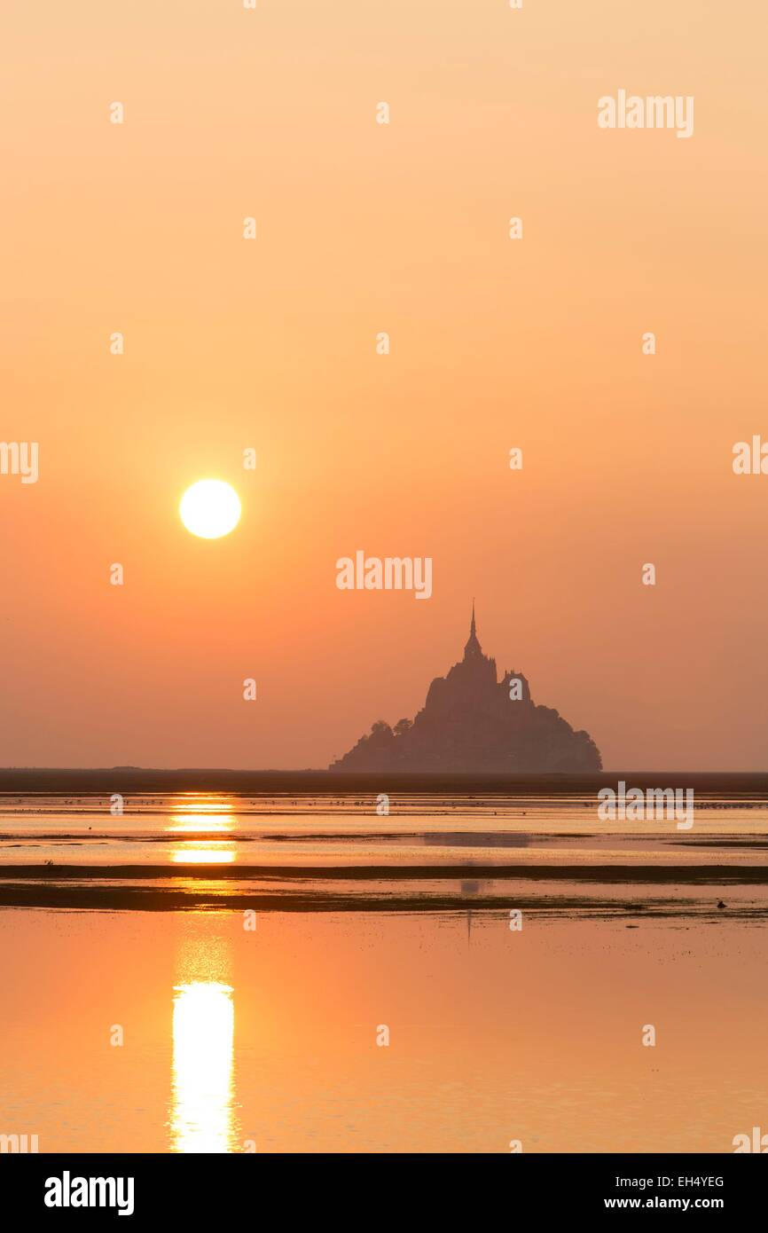 France, Manche, Mont Saint Michel bay, listed as World Heritage by UNESCO, sunrise on Mont Saint Michel at high - Stock Image