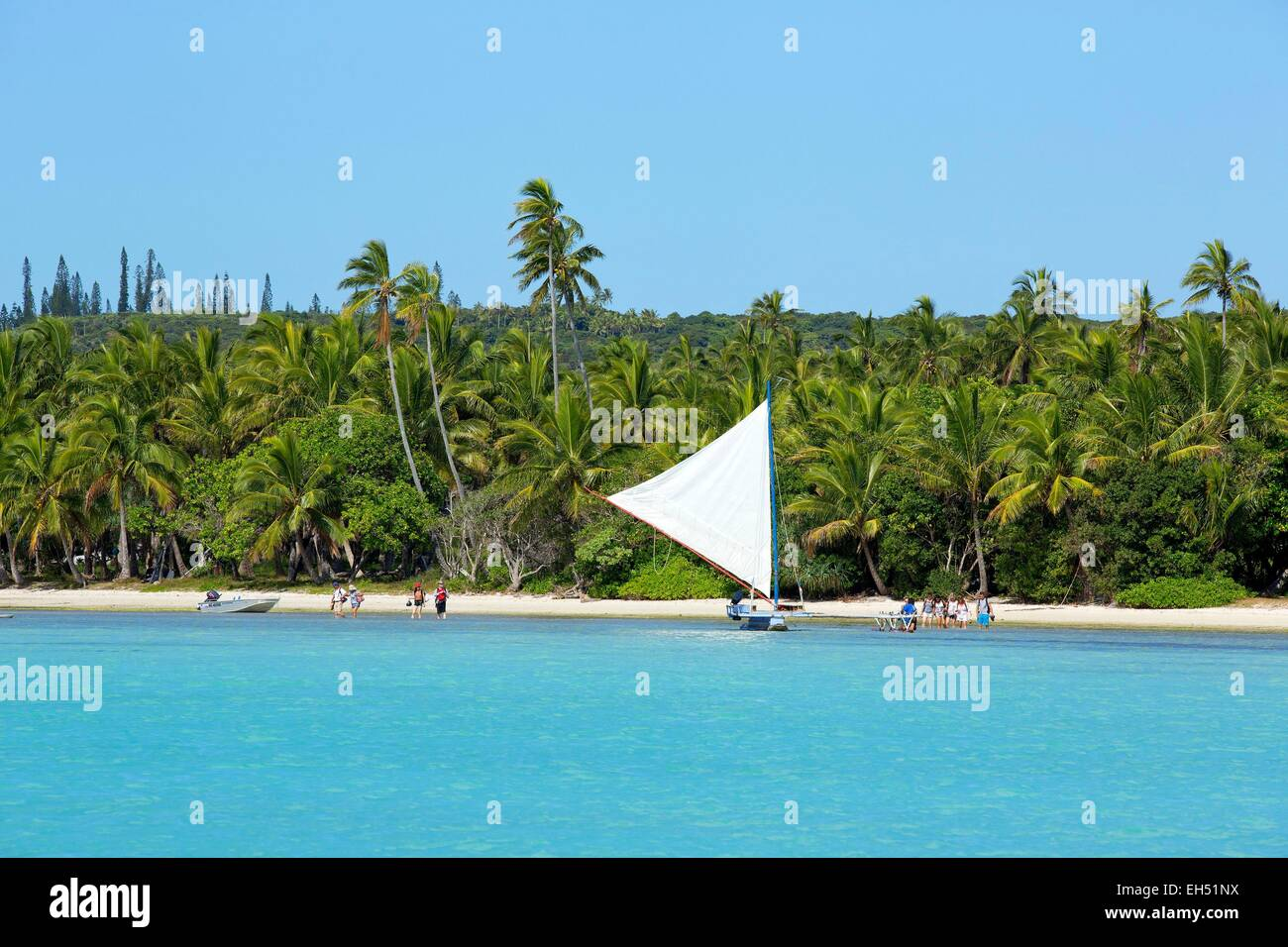 France, New Caledonia, Isle of Pines, outrigger boat in the bay of Saint Joseph, Lagoon listed as World Heritage - Stock Image