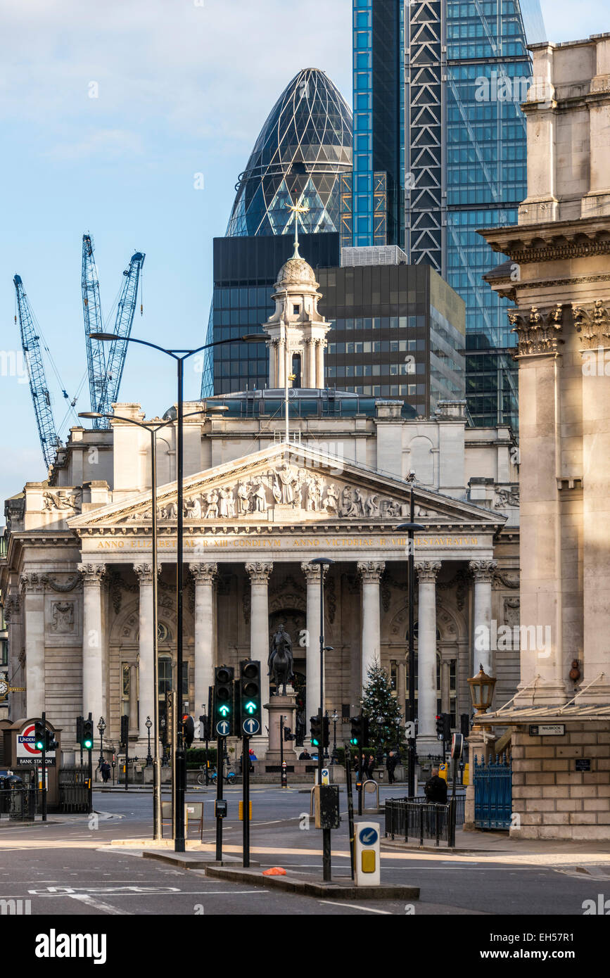 Views across Bank Junction to the Royal Exchange with the Gherkin and Cheesegrater in the background in the City - Stock Image
