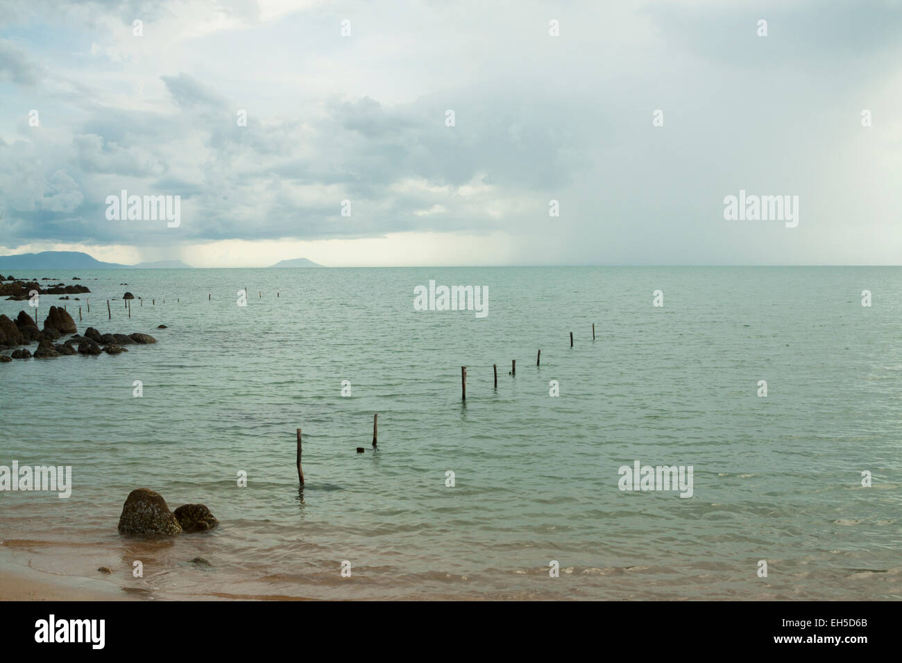 Tropical rainstorm approaching over the sea - Rabbit island (Tonsay island), Kep, Cambodia. - Stock Image