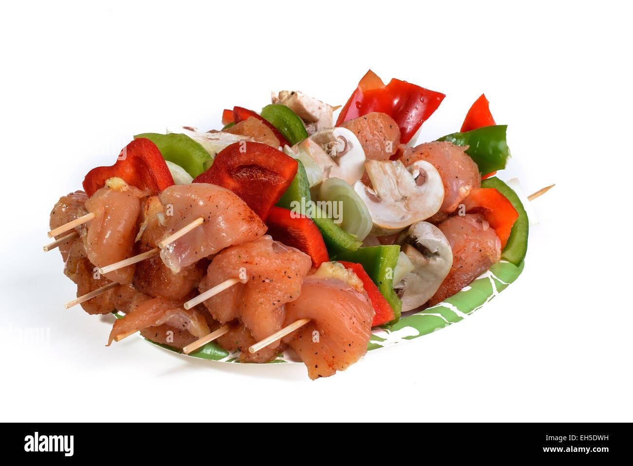 Fresh flesh meat shashlik with vegetables isolated on white - Stock Image