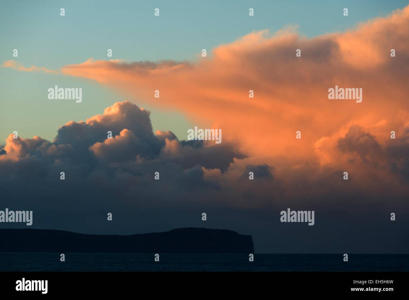 Cumulonimbus cloud over Dunnet Head at sunset, Caithness, Scotland, UK.  From St. John's Point, near the village - Stock Image