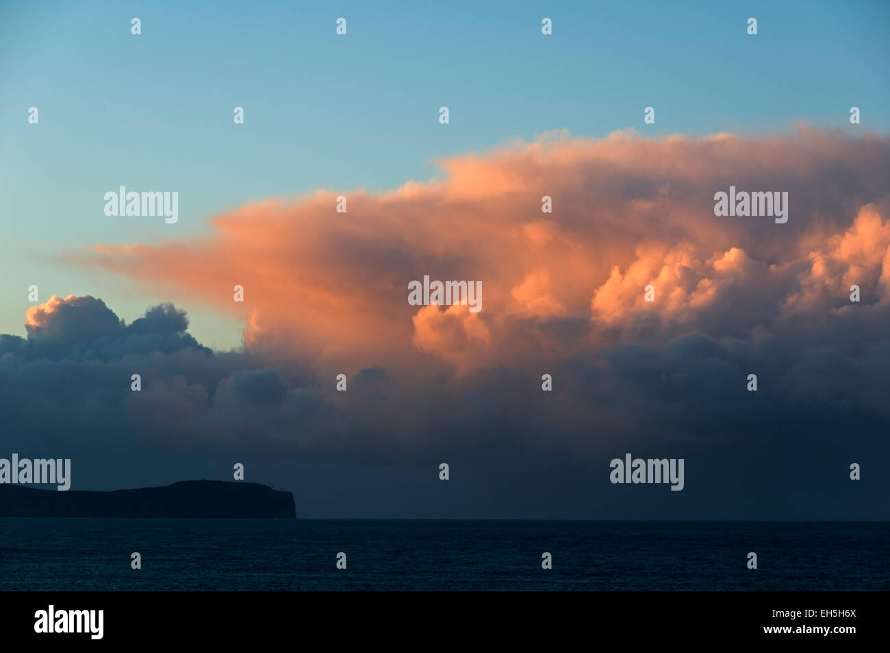 Cumulonimbus cloud over Dunnet Head at sunset, Caithness, Scotland, UK.  From St. John's Point, near the village - Stock Image