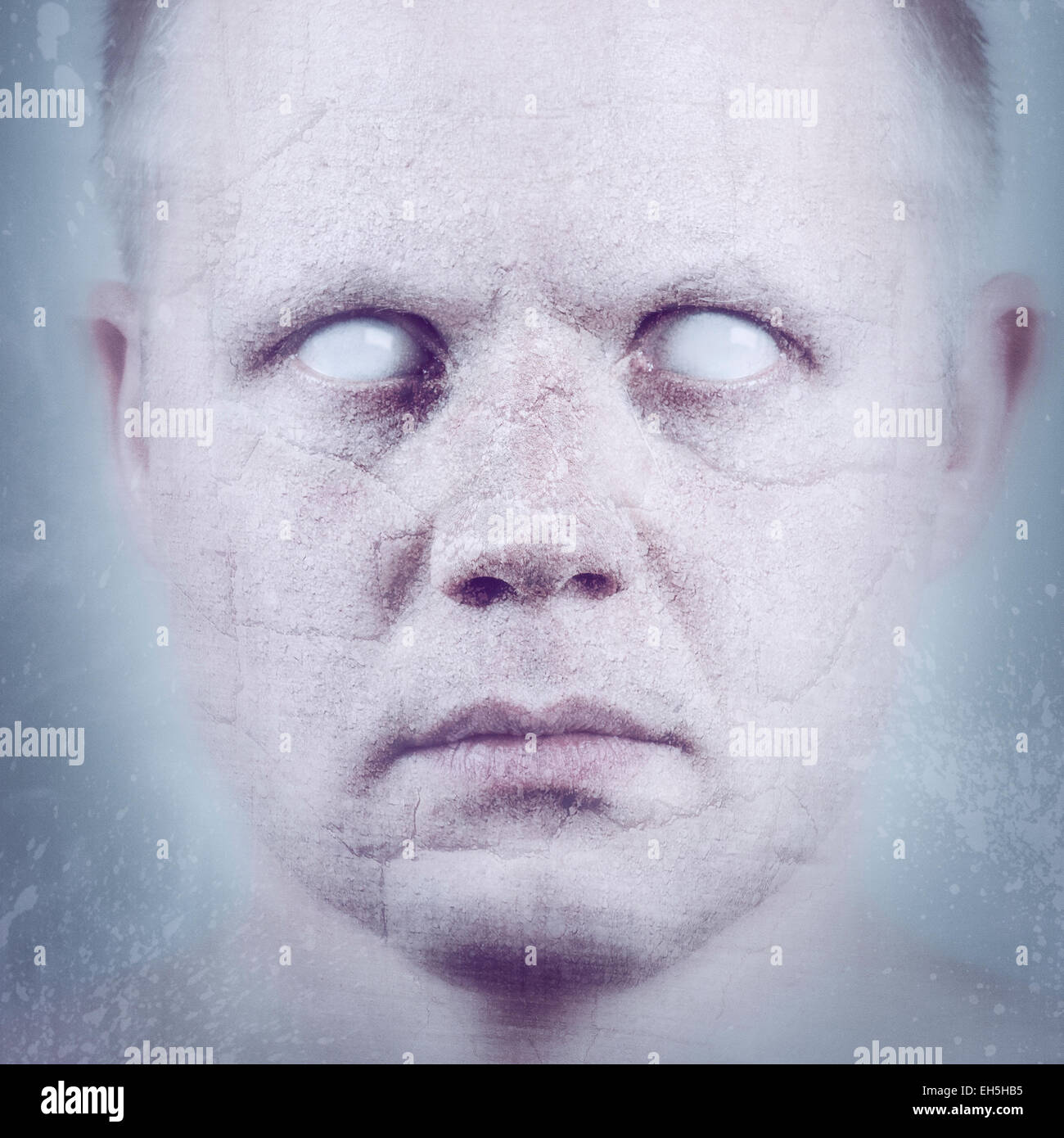 Scary man with white eyes in ice / stone. - Stock Image