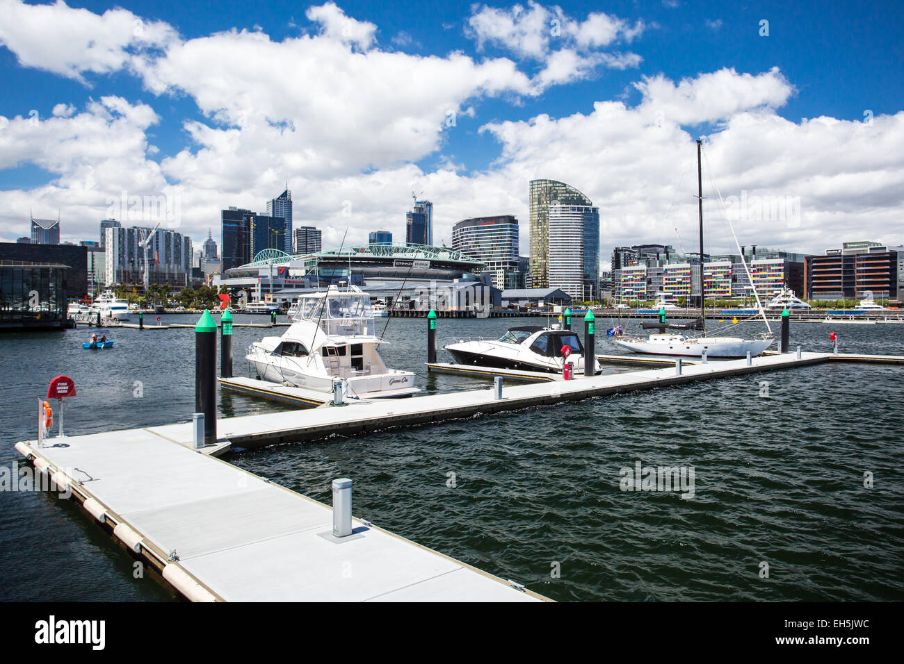 The famous Melbourne skyline from a pier at Docklands on a hot summer's day - Stock Image