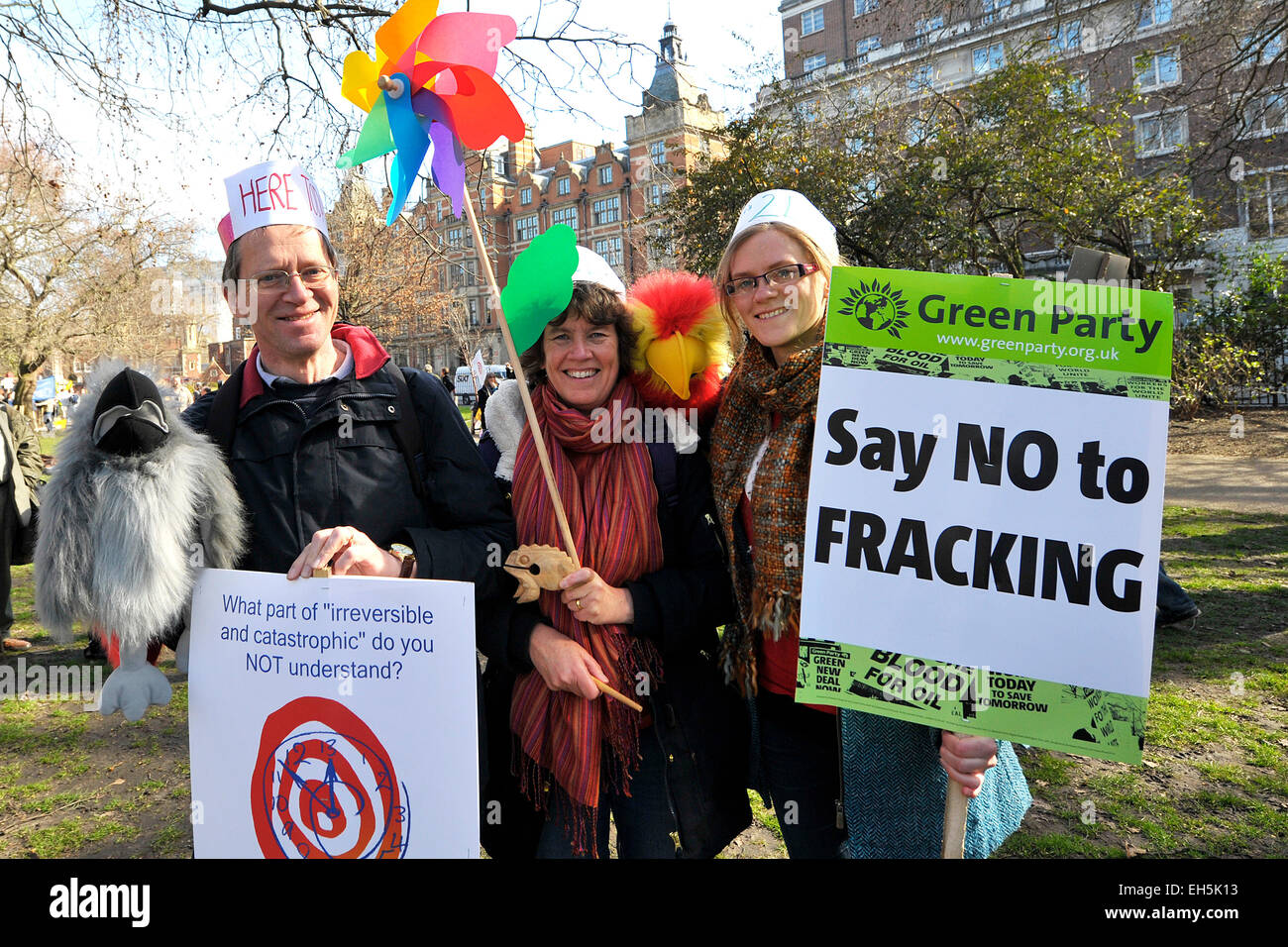London, UK. 7th March, 2015. As part of the 'Time to Act' demonstration today, Robert, Helen and Sarah have - Stock Image
