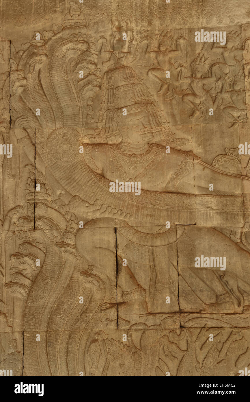 Sandtone carvings depicting hindu deities found in the walls of the Angkor temple complex in Cambodia. - Stock Image