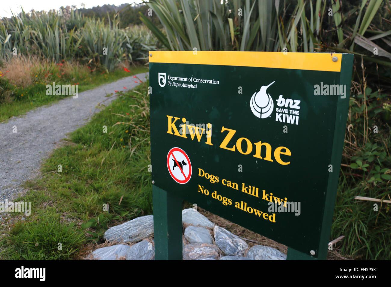 Kiwi zone conservation sign dog warning New Zealand - Stock Image