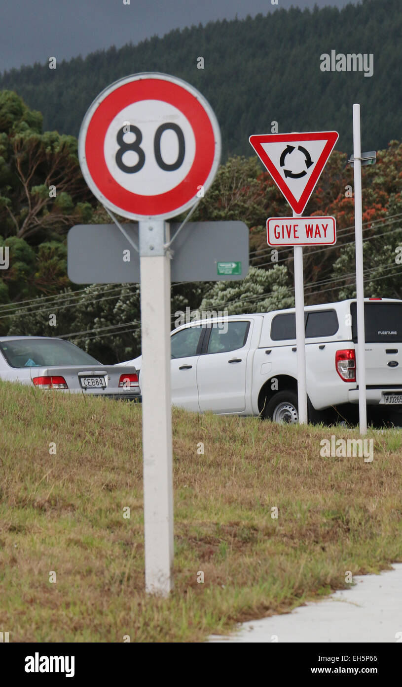 speed limit and Give way yield Road sign New Zealand round-a-bout - Stock Image