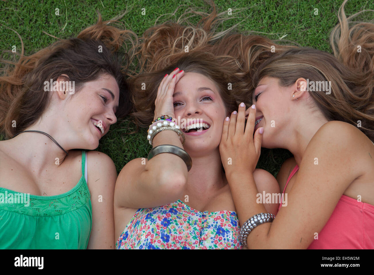teen girls whispering and gossiping secrets in summer holidays Stock Photo